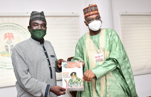 Editor-in-Chief Yushau A. Shuaib presents a copy of Economic Confidential to Minister of Communication and Digital Economy Dr Isa Pantami