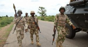 Troops-patrolling-Damboa-after-clearing-the-town-of-insurgents-374x200_c