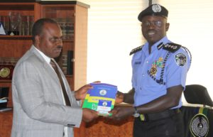 IGP presenting NPF Human Rights Manuel &  NPF standard  guidlines on 2015 elections to CEO of NHRC