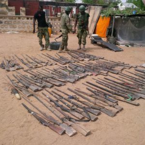 Assorted+rifles+discovered+by+troops+in+the+suburb+of+Bama