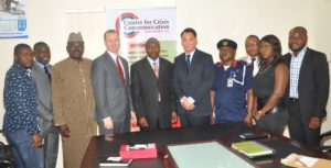 Executive Secretary Centre for Crisis Communication, Air  Commodore Yusuf Anas in group photograph with US Embassy officials during a visit to the Centre. With them are staff of the Centre