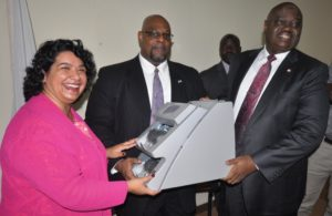 Deputy+Chief+of+Mission+Us+Embassy.Maria+Brewer+Presenting+Machine+to+EFCC+Chiarman.