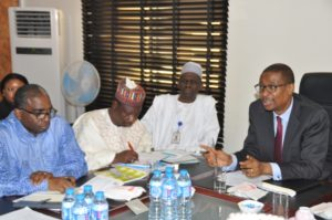 Dr.+Enelamah+listening+to+the+CEO+Nigeria+Export+Promotion+Council,+Chief+Segun+Awolowo+.