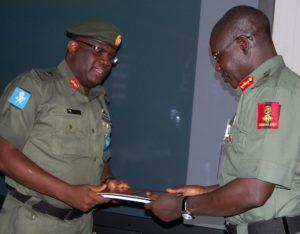 Major General Adeniyi Oyebade GOC 1 Division, submitting report to Chief of Army Staff, Lieutenant General Tukur Yusuf Buratai
