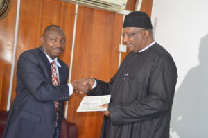 Air Commodore Yusuf Anas rtd make a presentation to Minister of Interior Lt Gen Dambazau in Abuja