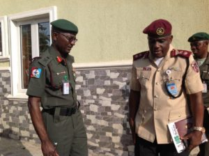 FRSC Commander Imoh Etuk with DDI Major General Enenche at FOSSRA Meeting