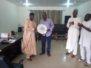 Dean Student Affairs BUK, Dr. Shamsudeen Umar receives presents from Publisher of PRNigeria, Yushau Shuaib after a Facebook Project Contest