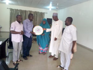 Dr. Hajara Umar Sanda Receives present after successful outing of BUK Students at Facebook sponsored Project