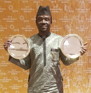 Yushau Shuaib, author and PR practitioner displays two Golden World Awards from IPRA in Barcelona, Spain