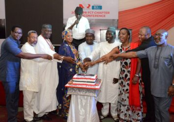 Guests cut the cake at FCT NIPR Annual Conference, Awards Event in Abuja