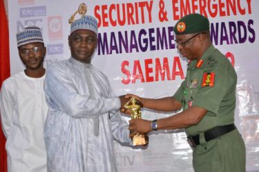 Brigadier General A. A. Goni receives the SAEMA Golden Tropgy from Defence Spokesperson, Brig Gen Nwachukwu