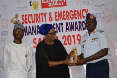 Mrs Toun Okewale present SAEMA Trophy to NAF Representative